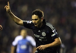Chelsea's Lampard celebrates after scoring during their English Premier League soccer match against Wigan Athletic in Wigan