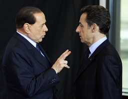 Italy's PM Berlusconi talks with France's President Sarkozy at emergency EU leaders summit in Brussels