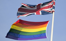 A rainbow flag flies with the Union flag above British Cabinet Offices, marking the first day Britain has allowed same sex marriages, in London