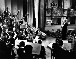 ONE HUNDRED MEN AND A GIRL, Leopold Stokowski (right), 1937