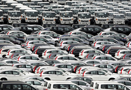 Japanese vehicles ready for shipment are parked at port in Yokohama