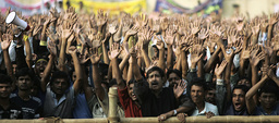 Supporters of Bangladesh Awami League waves during election campaign rally in Dhaka