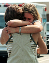 STUDENTS HUG OUTSIDE CHURCH FOLLOWING COUNSELLING SESSION
