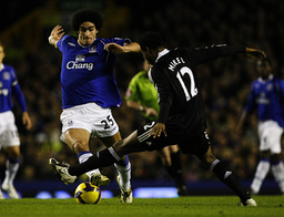 Everton's Fellaini challenges Chelsea's Mikel during their English Premier League soccer match in Liverpool