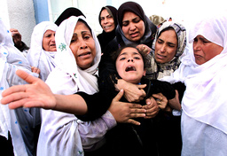 THE SISTER OF THE FOUR DEAD PALESTINIAN CRRIES DURING HER BROTHER FUNERAL IN GAZA STRIP