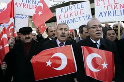 Demostrators shout slogans as they attend protest against state-run television channel in Kurdish language in Ankara