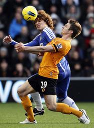 Chelsea's Luiz challenges Wolverhampton Wanderers' Doyle during their English Premier League soccer match in Wolverhampton