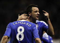 Chelsea's Frank Lampard celebrates his goal against Wolverhampton Wanderers with John Terry during their English Premier League soccer match at Molineux in Wolverhampton