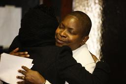 Anglican priest hugging a parishioner