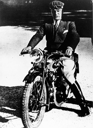 Dicator Benito Mussolini on a motorcycle