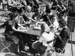 Female workers of a munitions factory during the lunch break, 1941