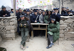 Worshippers wait to receive traditional food as they prepare to take part in Taoist festival in Fengjiashan village