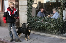 Greg Pike waits with animals while diners watch from restaurant in Bisbee, Arizona