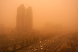A DUST STORM REDUCES VISIBILITY TO 500 METERS IN BEIJING.