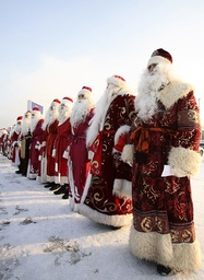 People dressed as Father Frost line up in the Siberian city of Krasnoyarsk
