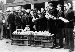 Congress candidates distribute food during the Great Depression, 1930