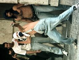 PROTESTER THROWS ROCKS AT RIOT POLICE IN BRAZIL