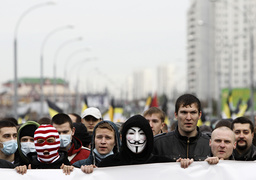 Russian ultra-nationalists take part in the so-called Russian March demonstration on the National Unity Day in the capital Moscow