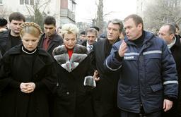 Ukraine's President Yushchenko and PM Tymoshenko visit shattered five-storey block in Black Sea resort of Yevpatoria in Crimea peninsula