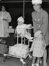 Actress Joan Collins With Her Daughters Tara Newley (2 1/2 Years) And Sacha Newley (8 Months) Arrives At London Airport From Hollywood.