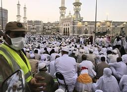 Pilgrims wait before prayers outside the Grand Mosque of Mecca in Saudi Arabia