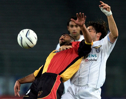 SS LAZIO'S GIANNICHEDDA CHALLENGES UMIT KARAN OF GALATASARAY IN ROME