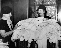 Members Of The Women's Voluntary Services For Civil Defence Distributing Garments Knitted By Daily Mail Readers In Response To The 'daily Mail Knitting Appeal For Evacuated Children And Hospitals'. Socks That Have Been Knitted By Daily Mail Reader