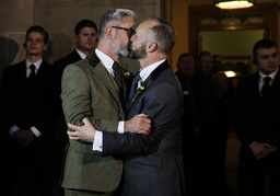 Andrew Wale and Neil Allard kiss after marrying in the first same-sex wedding in Brighton, at the Royal Pavilion in southern England
