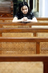 An Indonesian woman prays at Jakarta's main cathedral