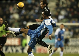 Wigan Athletic's Hall challenges Chelsea's Robben for the ball during their English Premier League soccer match in Wigan
