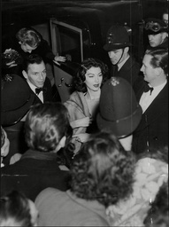 Frank Sinatra And Wife Ava Gardner Leaving For The Midnight Matinee At The London Coliseum.