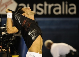 29 01 2012 Melbourne Australia Djokovic tears his shirt away after winning the match on Day 14 of