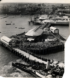 Aerial View Of The Pier And Beach At Clacton-on-sea In Essex. Picture Shows Crowds Lining Up On The Pier To Travel On The Paddle-steamer.