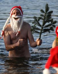 A members of Berlin's ice swimming club Berliner Seehunde takes a dip in Orankesee lake in Berlin