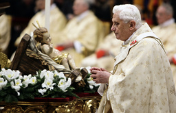 Pope Benedict XVI walks next the nativity scene as he leads the Christmas Mass in Saint Peter's Basilica at the Vatican