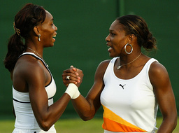 FILE PHOTOGRAPH SHOWS THE WILLIAMS SISTERS SHAKING HANDS AFTER WINNING AT THE WIMBLEDON TENNIS CHAMPIONSHIPS