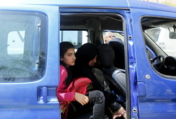 Released Palestinian prisoner Deema Al-Wawi, who was detained by Israeli authorities for around two and half months, sits with her mother in a vehicle following her release near the West Bank city of Tulkarm
