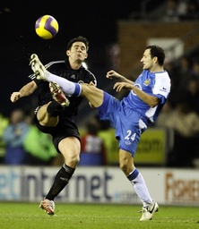 Wigan Athletic's Skoko challenges Chelsea's Lampard for the ball during their English Premier League soccer match in Wigan