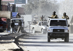 Paramilitary soldiers patrol a road during a curfew in the Khyber tribal agency on the outskirts of Peshawar