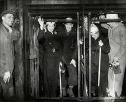 Sir Bernard Docker Chairman Of Bsa And Lady Docker (norah Collins) In Lift At Yorkshire Coal Mine Surrounded By Miners 1954.