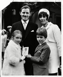 Graham Hill Is Honoured With An Obe After Winning His Second World Title. Proud Wife Betty And Children Brigitte And Damon Accompany Graham To Buckingham Palace For The Investiture. 12/11/1968