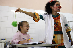 A Clown-doctor entertains patients in Heim Pal Hospital in Budapest