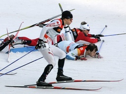 Canada's Kershaw skis in front of crashed Pettersen from Norway and Sweden's Fredriksson during the first of four 'Tour de Ski' Cross Country World Cup competitions in Munich's Olympic stadium
