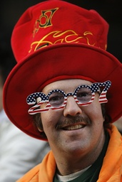 A man wears celebratory gear as revelers begin to gather at Times Square in the afternoon as part of New Year's Eve celebrations in New York