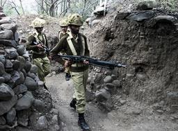 PAKISTANI SOLDIERS PATROL THEIR BUNKER IN PAKISTAN CONTROL OF KASHMIR