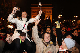 Revellers celebrate the New Year on the Champs Elysees avenue in Paris