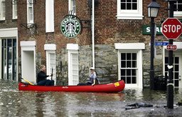 CANOEISTS MAKE THEIR WAY THROUGH THE STREETS OF OLD TOWN ALEXANDRIA