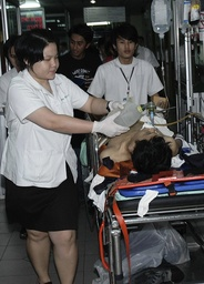Victims are taken to hospital after bomb blasts in Bangkok