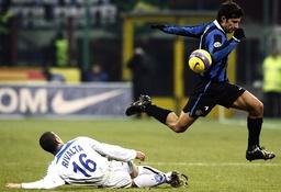 Inter Milan Figo challenges Atalanta Rivalta during their Italian Serie A soccer match in Milan