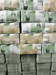 Stacks of ten thousand Korean won bills are piled up at the headquarters of the Korea Exchange Bank in Seoul